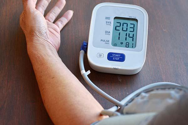 checking blood pressure mfine