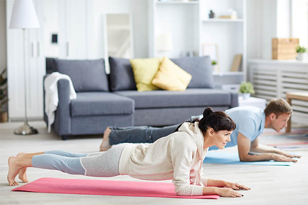 couple exercise at home binge-watching mfine